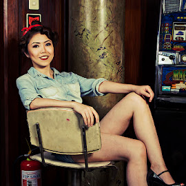 Nica by Eric Agulto - People Portraits of Women ( chair, sitting, fire hydrant, female, bar, slot machine )