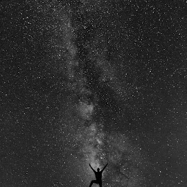 Is there anybody out there ? by Amir Ehrlich - Black & White Landscapes ( hill, mountain, black and white, silhouette, long exposure, night, milky way, human )