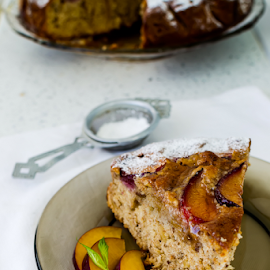 Plum cake by Yancho Zapryanov - Food & Drink Cooking & Baking ( home, nobody, tart, cuisine, powder, circle, homemade, baked, fresh, meal, dessert, cake, fruit, plums, white, mint, plate, delicious, pie, sweet, whole, food, background, pastry, natural, culture, sugar )