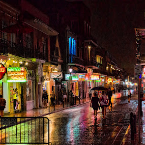 Raining on Bourbon St by Allen Ramlow - City,  Street & Park  Street Scenes ( rain bourbon street french quarter new orleans night )