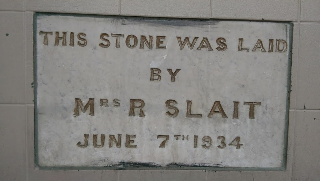 A plaque on the exterior of the Moonah Hotel, Main Road, Moonah, Tasmania. It reads: THIS STONE WAS LAID BY MRS R SLAIT JUNE 7TH 1934 There seems to be little information about Mrs R Slait or why she ...