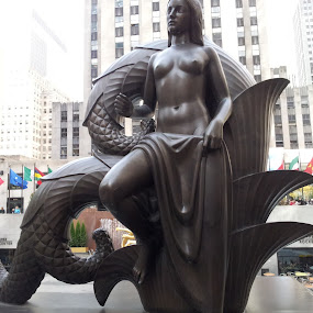 Maiden by Laurel Rowe - Instagram & Mobile Android ( bronze, sculpture, flags, nude, female, rockefeller center, maiden, nyc, city.skyscrapers )