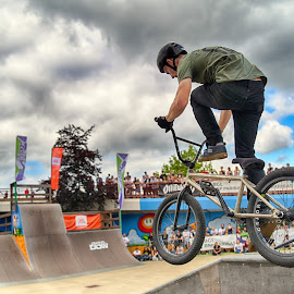 by Marco Bertamé - Sports & Fitness Other Sports ( clouds, flying, wheel, cloudy, grey, dow, jump, bicycle )
