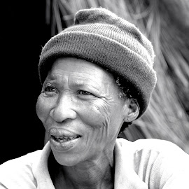 San woman in Namibia. by Lorraine Bettex - Black & White Portraits & People