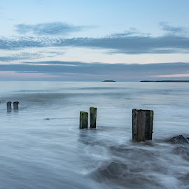 Youghal strand sunset by John Holmes - Landscapes Beaches ( sky, waves, soothing, old, clouds, long exposure, sea, peacefull, eathered, rocks, beach, groynes, wood, coastal )