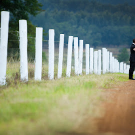 White Picket fence by Albert de Weerd - Wedding Bride & Groom