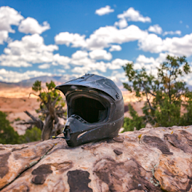 Helmet for off-roading vehicles in Moab Utah by Jason Finn - Sports & Fitness Motorsports ( dunes, mountain, bright, rocky, object, boulder, valley, helmet, usa, exploration, geology, adventure, sky, nature, cold, pink, dirt, black, moab, sand, desert, dry, hdr, purple, colors, rough, close up, blue, textured, wide angle, outdoors, day, lifestyles, off-roading )
