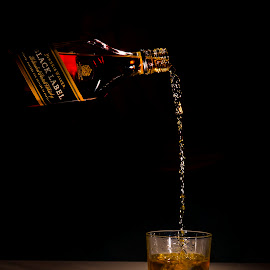 Black Label by Paul Cousins - Food & Drink Alcohol & Drinks ( on the rocks, johnny walker, whiskey, black label, pouring, bottle )