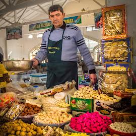 A Merchant at Bukhara Bazaar, Republic of Uzbekistan by Sergey Sibirtsev - City,  Street & Park  Markets & Shops ( bukhara, market, merchant, uzbekistan, bazaar, seller,  )