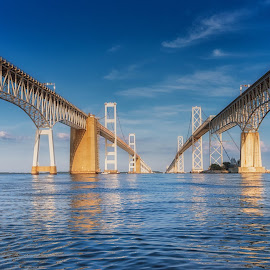 Between the Spans by Carol Ward - Buildings & Architecture Bridges & Suspended Structures ( annapolis, chesapeake bay bridge, reflection, maryland, architecture, bridge )