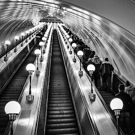 Up and down in black and white . by Nelida Dot - Buildings & Architecture Other Interior ( escalator, symmetry, metro, stairs, station, lights, architecture,  )