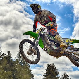 Smooth Flight by Marco Bertamé - Sports & Fitness Motorsports ( clouds, wheel, speed, green, number, yellow, race, noise, jump, flying, red, motocross, 82, cloudy, air, grey, high )