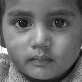 Face of Future India  by Doug Hilson - Babies & Children Child Portraits ( child, face, wispy hair, dark eyes, girl, big eyes, lips, innocence, portrait, eyes )