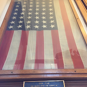 THIS FLAG WAS DRAPED OVER THE CASKET OF ARTHUR GILBERT ROOD KILLED IN ACTION AT CHATEAU THIERRY, JULY 27, 1918, WHEN HIS BODY WAS RETURNED TO AMERICA ARTHUR ROOD WAS BORN JULY 6, 1894; LIVED AT 998 ...