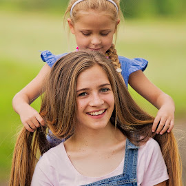 sisters hair by Wendy Berning - Babies & Children Child Portraits ( sister, love, smile )