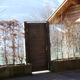 Door to the lake by Serguei Ouklonski - Buildings & Architecture Homes ( home, building, mountain, walensee, switzerland, door, st gallen, lake, architecture, house, wall )