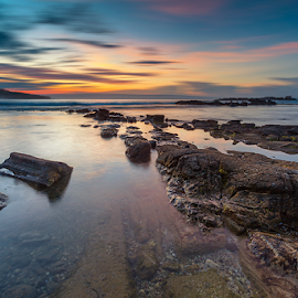 Welcoming Sunrise by Rio Tanusudiro - Landscapes Sunsets & Sunrises ( coral, colors, rock, sunrise, beach, morning, light )