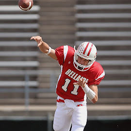 Releasing the ball by Keith Johnston - Sports & Fitness American and Canadian football ( field, player, high school, football, quarterback, stadium, competitor, passing, throwing, athlete, pass )