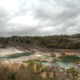 Pedernales Falls by Bonnie Davidson - Landscapes Weather ( water, clouds, limestone, photograph, green, johnson city, texas, gray, landscape, sky, state park, beige, pedernales falls, slabs, trees, weather, brown, weeds )
