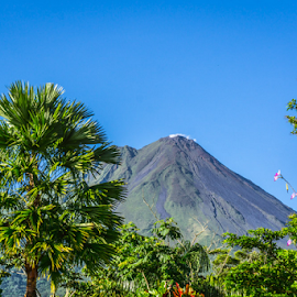 Volcano Scene by Laurie Crosson - Landscapes Mountains & Hills ( blue sky, arenal, costa rica, volcano, arenial, landscape )