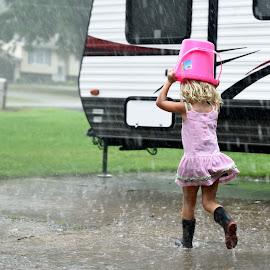 Running in the Rain by Brian Frackelton - Babies & Children Children Candids ( child, bucket, running, boots, rain )