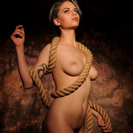 Twining on the Bicep by DJ Cockburn - Nudes & Boudoir Artistic Nude ( studio, art nude, cannon ball, model, nude, rope, woman, estrany, hessian, tattoo, standing )