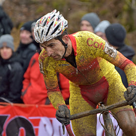 Spanish Power by Marco Bertamé - Sports & Fitness Cycling ( 49, spanish, cyclo-cross, concentrated, number, yellow, helmet, race, championships, bicycle, muddy, rider, red, uci, determined, world, man )