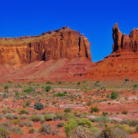 Monument Valley's Eagle Mesa Panorama by Steven Love - Landscapes Travel ( monument valley, famous, landmark, utah, arizona, sandstone, rock, view, landscape, panorama, navajo indian reservation, formation )