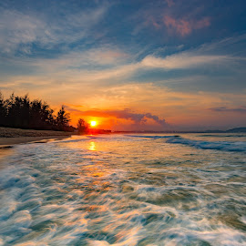 Sunrise at Sanya, China by Stanley Loong - Landscapes Sunsets & Sunrises ( waterscape, waves, warmth, sanya, beach, scenery, sunrise, slow shutter, china )