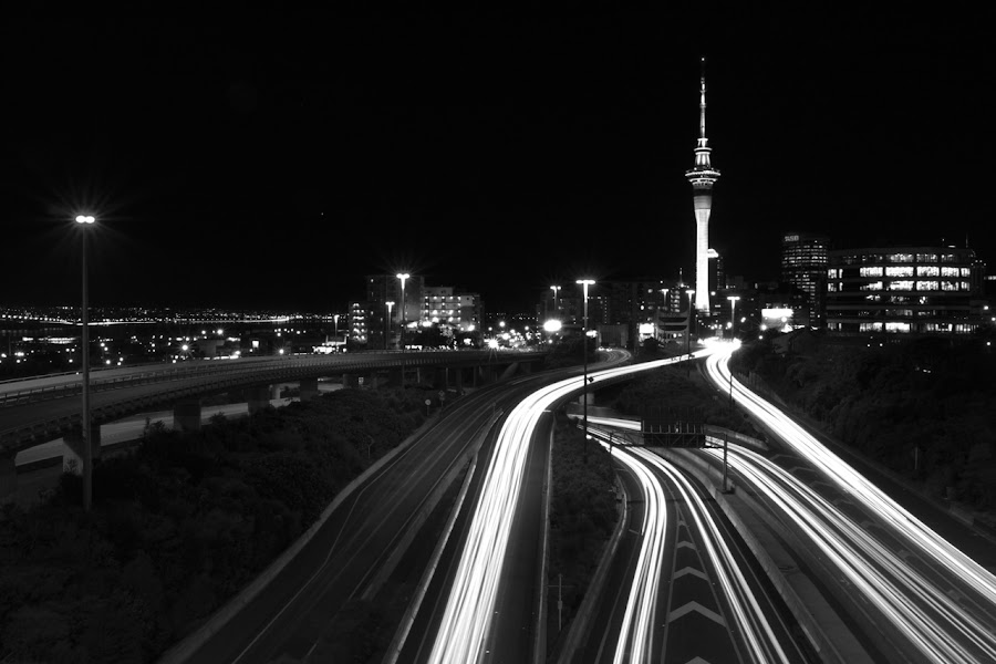 Auckland CBD by Sven Schroeter - City,  Street & Park  Vistas ( canon, imagery, b&w, auckland, sven, white, way, wide, schroeter, angle, tower, new, cbd, sky, motor, zealand, trails, light, black )