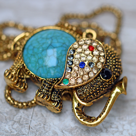 An elephant necklace. by Dipali S - Artistic Objects Other Objects ( fashion, elephant, deocorative, selective focus, artistic, srones, jewelry, bokeh, necklace )