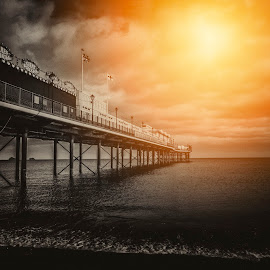A light in the darkness by Andy Toby - Landscapes Waterscapes ( paignton, sunset, devon, pier, seascape, golden, sun )