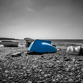 Blue Boat at El Golfo Beach by Michael Roberts - Digital Art Things ( selective color, black and white, boats, artistic, scenic, beach, landscape )