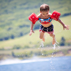 Flying by Richard States - Babies & Children Children Candids ( water, flying, happy, summer, boy )