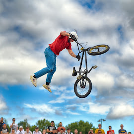 Standing In The Air by Marco Bertamé - Sports & Fitness Other Sports ( clouds, red, wheel, blue, cloudy, grey, air, dow, high, standing, jump, bicycle )