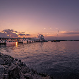 Marine Parkway Sunset by Sergei Shneider - Buildings & Architecture Bridges & Suspended Structures ( water, clouds, rockaway, marine parkway, ocean, architecture, nyc, new york, ny, newyork, sun, sky, queens, sunset, bridge, brooklyn )