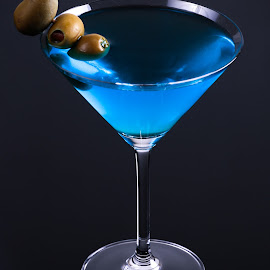 Martini with Olives by Tom Whitney - Food & Drink Alcohol & Drinks ( vertical, smooth, vermouth, stuffed, crystal, vodka, refreshing, pimento, beverage, blue, gin, drink, cocktail, glass, black, olives )