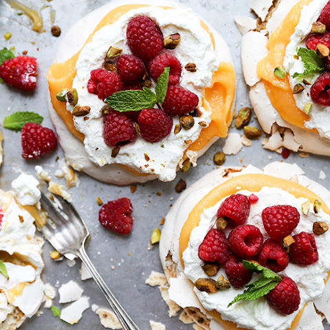 Pistachio Pavlovas with Papaya Curd and Fresh Raspberries