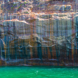 Not As It Seems by Jill Laudenslager - Landscapes Caves & Formations ( water, mountain, colors, jade, green, cliff, lake superior, lake, cave, pure michigan, michigan, bleeding color, color, minerals, wall )