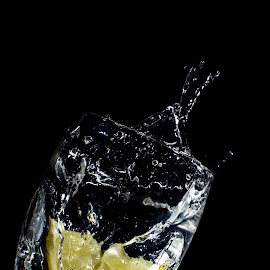 G&T anyone?  by Lorraine Paterson - Food & Drink Alcohol & Drinks ( splash, alcohol, gin, drink, fast shutter speed, tonic, lemon )
