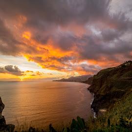 Won't let you go. by Rubina Delgado - Landscapes Sunsets & Sunrises ( clouds, orange, saudade, joy, sunset, warmth, travel, landscape, portugal, madeira, sun, island )