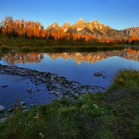 Morning Glory Over Grand Teton Mounts by Al Juniarsam  - Landscapes Mountains & Hills