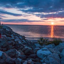 Hefner Lighthouse Sunset by Kathy Suttles - Landscapes Sunsets & Sunrises ( okc, orange, flag, blue, colorful, sunset, lighthouse, hefner lake )