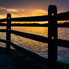 Sunset at Little Seneca Lake, with fence (2/2) by Brian Butters - Buildings & Architecture Bridges & Suspended Structures ( water, black hill regional park, sky, winter, sunset, weather, little seneca lake )