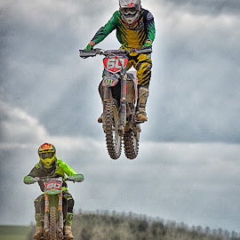 Air Fighters by Marco Bertamé - Sports & Fitness Motorsports ( speed, green, 90, number, yellow, race, sun rays, jump, noise, red, motocross, dust, cloudy, air, grey, high, 60, duel )