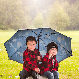 Under my Umbrella by Jenny Hammer - Babies & Children Children Candids ( umbrella, boys, raining, cute, cousins, kids )