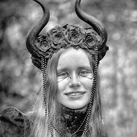 by Marco Bertamé - Black & White Portraits & People ( horns, decoration, blond, blur, long, sdof, bokeh, teeth, rose, chain, woman, smile, head, hair, flower )