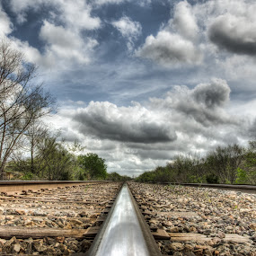 Journey of a thousand miles by Fitz C - Landscapes Travel ( clouds, distance, sky, blue, green, railroad, rail, cloud, landscape, rocks )