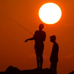 Fishermen at sunset by Yuval Shlomo - People Street & Candids