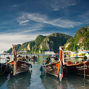 Long tail boats Ko Phi Phi Thailand by Eric Montalban - Landscapes Travel ( sky, blue, thailand, ocean, boat, long tail )